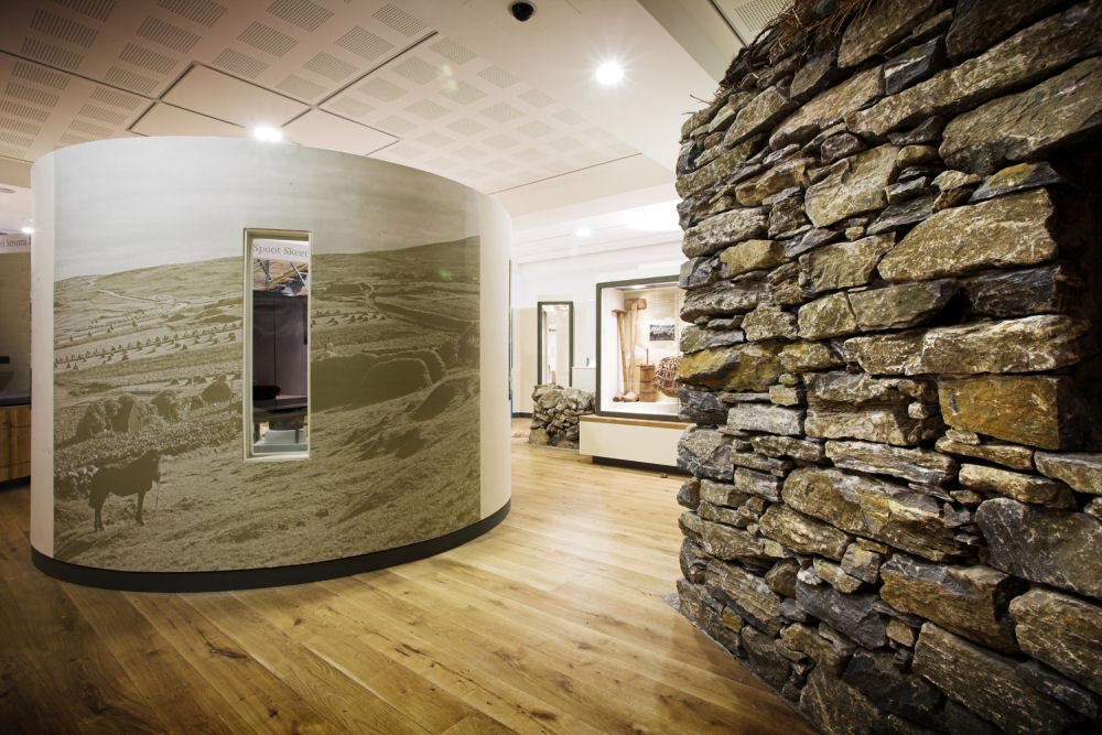 Wall cladding for interiors mark corporation for Rock wall designs interior